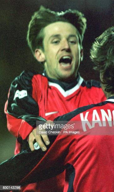 Neil McCann celebrates with teammate Andrei Kanchelskis after his first goal for Rangers against Kilmarnock during their Scottish Premier League...