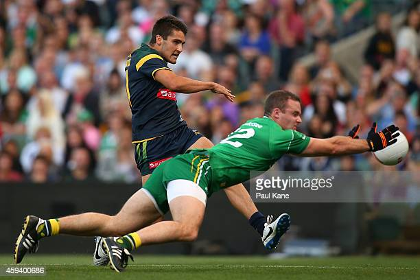 Neil McGee of Ireland attempts to smother a kick on goal by Chad Wingard of Australia during the International Rules Test Match between Australia and...