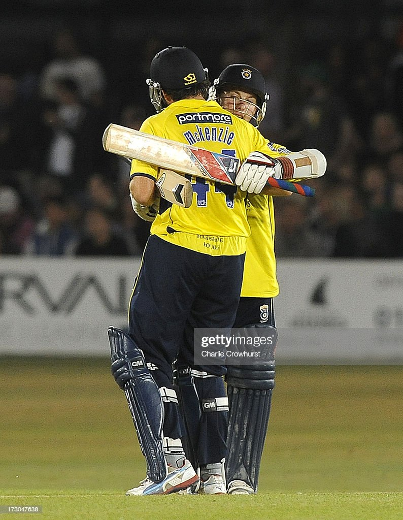 Neil McKenzie and Adam Wheater celebrate the teams win during the Friends Life T20 match between Sussex Sharks and Hampshire Royals at The Brighton and Hove Jobs County Ground on July 05, 2013 in Hove, England.