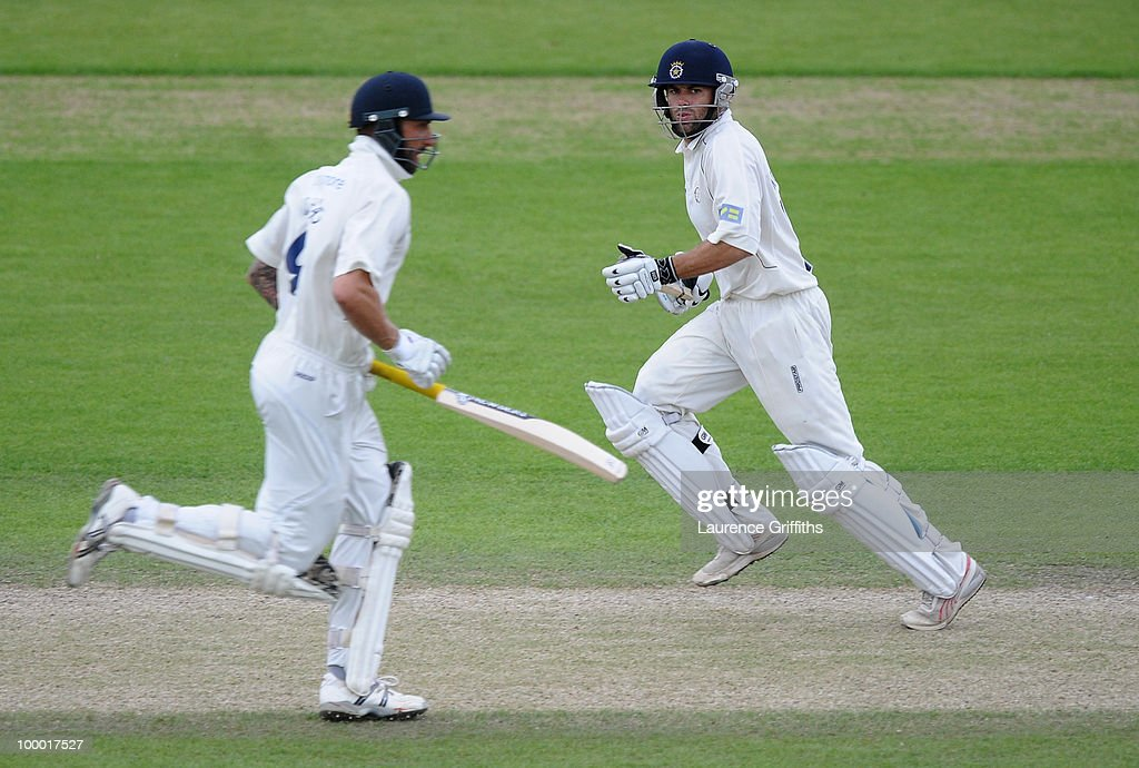 Neil McKenzie of Hampshire chases down the runs with Nic Pothas during the LV County Championship match between Nottinghamshire and Hampshire at Trent Bridge on May 20, 2010 in Nottingham, England.