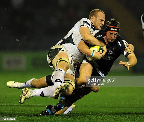 Neil McMillan of Sale Sharks is tackled by Matt Garvey of London Irish during the LV Anglo Welsh Cup match between Sale Sharks and London Irish at...