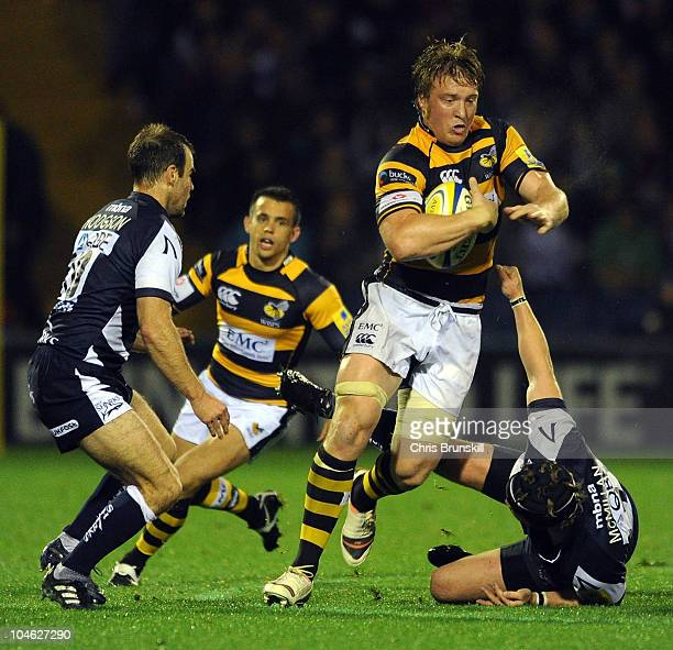 Neil McMillan of Sale Sharks tackles Andy Powell of London Wasps during the AVIVA Premiership match between Sale Sharks and London Wasps at Edgeley...