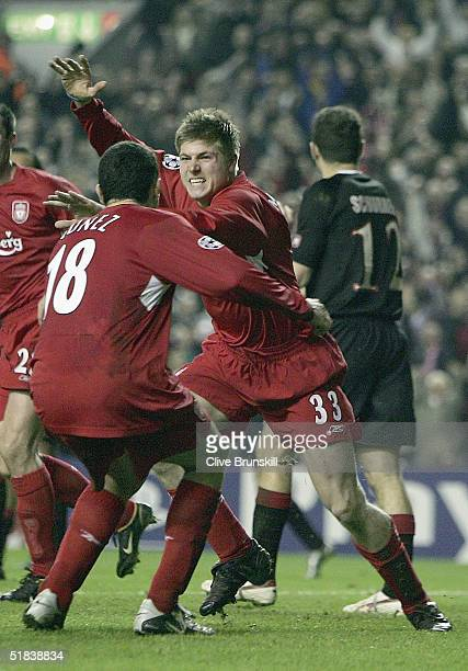 Neil Mellor of Liverpool celebrates the scoring the second goal during the Champions League Group A match between Liverpool and Olympiakos at Anfield...