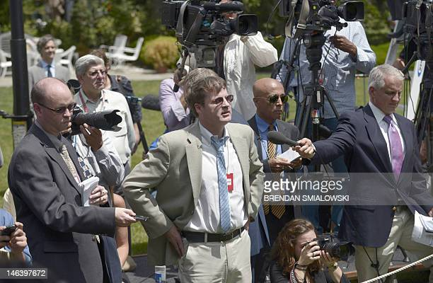 Neil Munro, a reporter from the Daily Caller interrupts US President Barack Obama as he speaks in the Rose Garden during a press conference on...