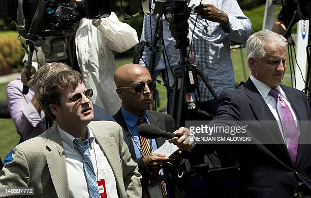 Neil Munro a reporter with the online publication The Daily Caller, shouts a question interupting US President Barak Obama during an event in the...