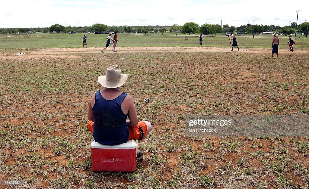 Neil Newton of the team 'Joes' fields while sitting on an esky full of alcoholic drinks during the Goldfield Ashes January 27, 2007 in Charters Towers, Australia. Due to heavy overnight rain the three day cricket carnival was cancelled however several teams still came out and played.Every Australia Day weekend the small outback town of Charters Towers in North Queensland hosts a cricket carnival named 'The Goldfield Ashes'. In 1949 the Charters Towers Cricket Association extended an invitation to six town to play on Foundation Day. From those six teams the carnival has grown to a record 194 teams competing in 2007, making it the largest carnival of its type in the world. The Goldfield Ashes swells the 8000 strong population of Charters Towers, near Townsville, by about 3000 and attracts teams of solicitors, engineers and television crews from as far as Brisbane. Matches are played on 58 different playing fields, including some which are privately owned. It is one of the few sporting carnivals which caters for players of all levels of ability