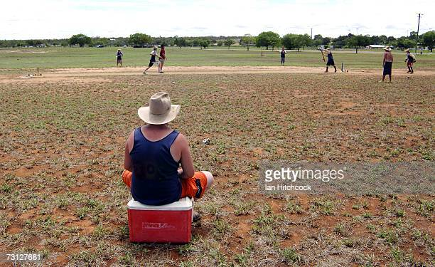 Neil Newton of the team 'Joes' fields while sitting on an esky full of alcoholic drinks during the Goldfield Ashes January 27 2007 in Charters Towers...