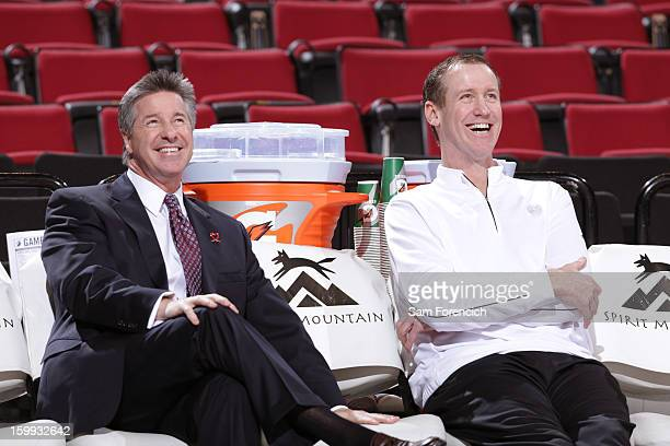 Neil Olshey the General Manager of the Portland Trail Blazers and Terry Stotts of the Portland Trail Blazers sit on the bench before the game against...