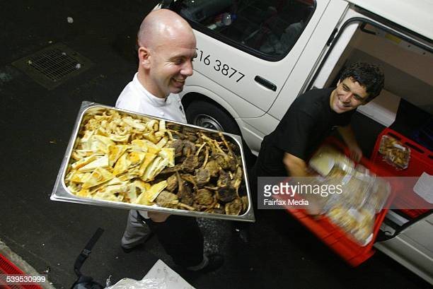 Neil Pass from the Cabinet Catering at Luna Park gives Joan Jaure from Oz Harvest leftover food which will be distributed among the homeless 11...