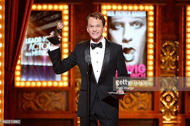 Neil Patrick Harris accepts the award for Best Performance by an Actor in a Leading Role in a Musical for Hedwig and the Angry Inch onstage during...