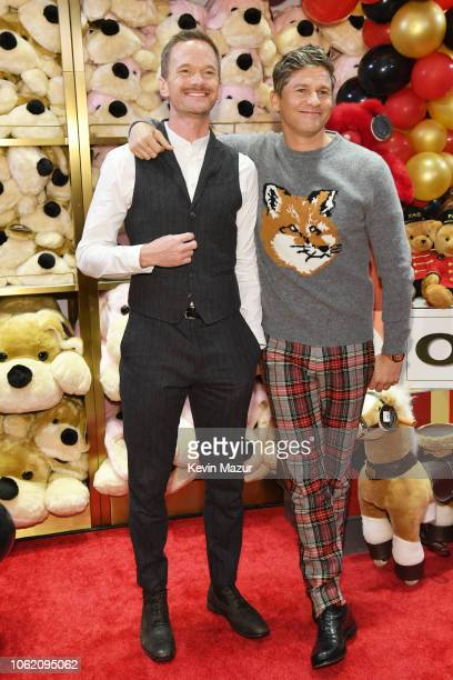 Neil Patrick Harris and David Burtka attend as FAO Schwarz opens its flagship store at 30 Rockfeller Plaza on November 15 2018 in New York City