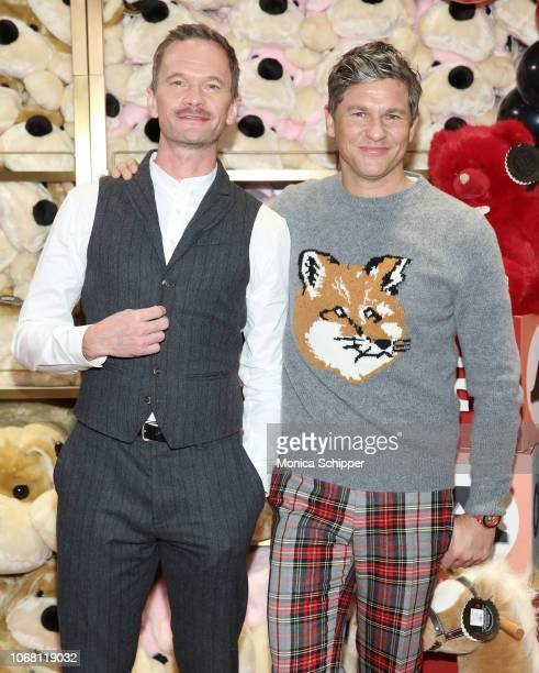 Neil Patrick Harris and David Burtka attend the FAO Schwarz Grand Opening Event at Rockefeller Plaza on November 15 2018 in New York City