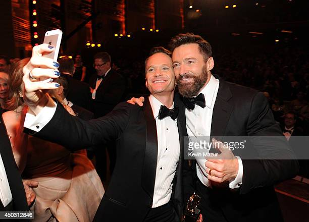 Neil Patrick Harris and Hugh Jackman attend the 68th Annual Tony Awards at Radio City Music Hall on June 8 2014 in New York City