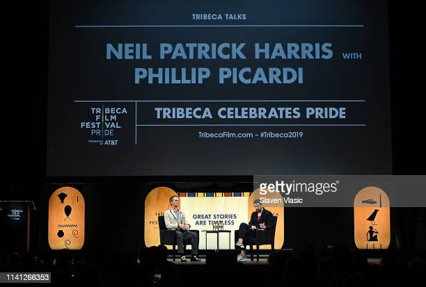 Neil Patrick Harris and Phillip Picardi speak on stage at Tribeca Celebrates Pride Day at 2019 Tribeca Film Festival at Spring Studio on May 4 2019...