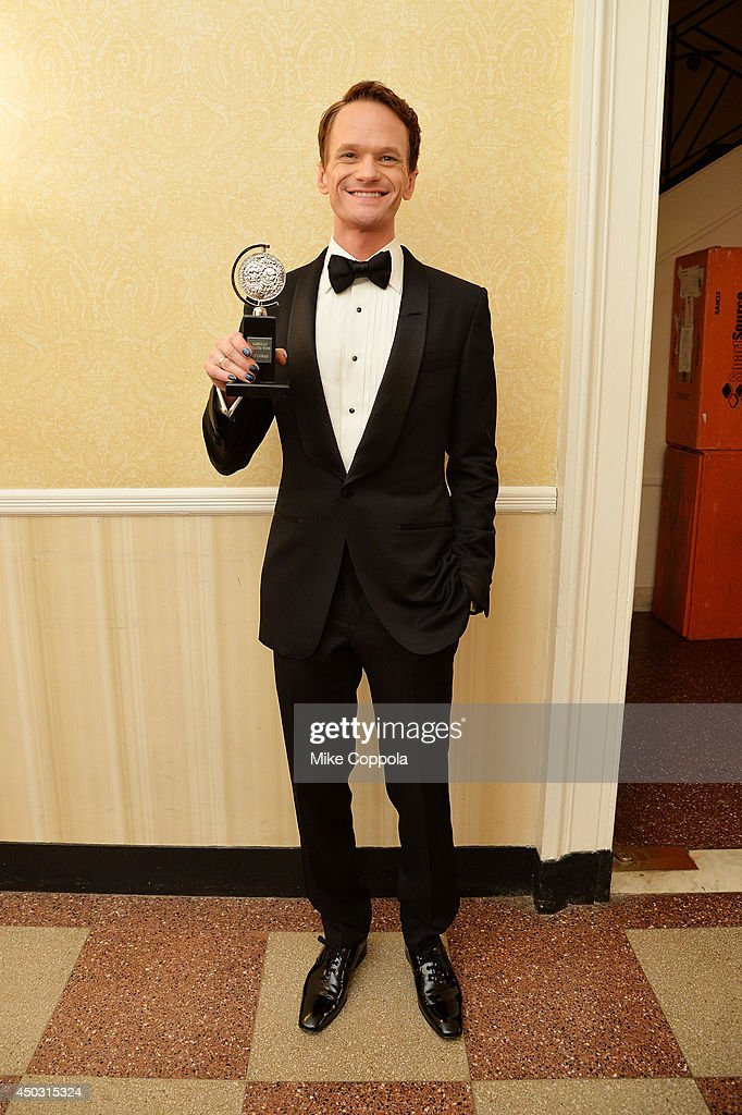 "Neil Patrick Harris, winner of the award for Best Performance by an Actor in a Leading Role in a Musical for ""Hedwig and the Angry Inch"", poses in the Paramount Hotel Winners' Room at the 68th Annual Tony Awards on June 8, 2014 in New York City."