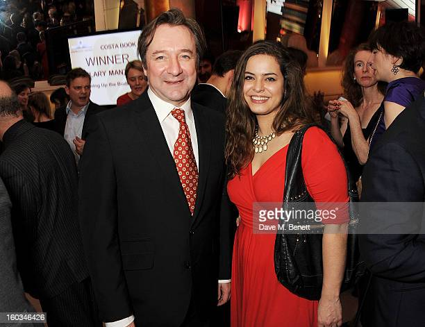 Neil Pearson and guest attend a drinks reception at the 2012 Costa Book of the Year awards at Quaglino's on January 29 2013 in London England