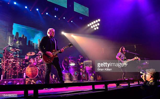 Neil Peart Alex Lifeson and Geddy Lee of the group Rush perform at the Prudential Center on October 20 2012 in Newark New Jersey