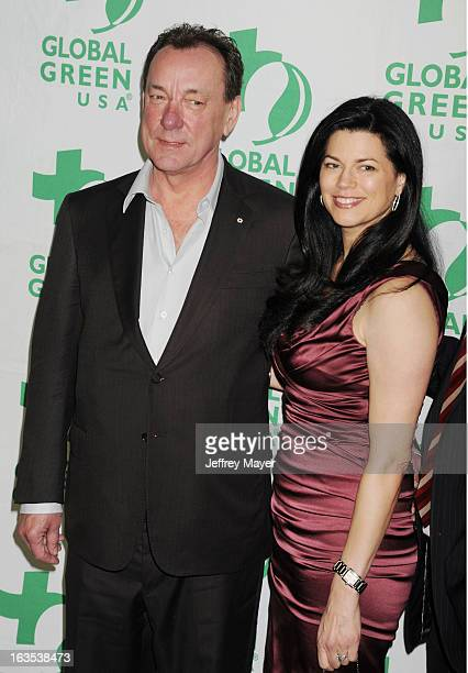 Neil Peart and Carrie Nuttall arrive at Global Green USA's 10th Annual PreOscar party at Avalon on February 20 2013 in Hollywood California
