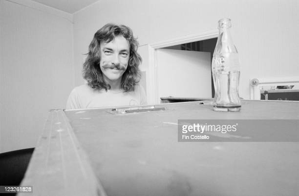 Neil Peart drummer with Canadian rock band Rush poses behind a luggage trunk backstage at the Gaumont in Southampton Hampshire England United Kingdom...
