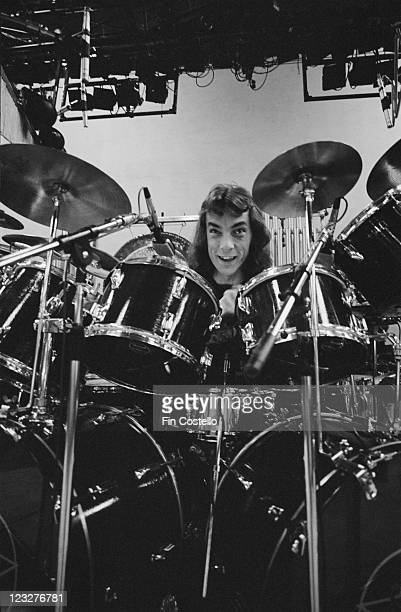 Neil Peart drummer with Canadian rock band Rush sitting behind his drumkit on stage during a soundcheck ahead of the band's gig at Bingley Hall in...