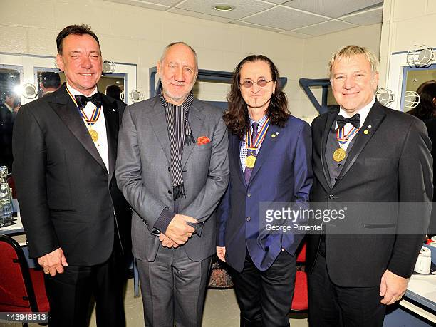 Neil Peart Geddy Lee and Alex Lifeson of Rush pose with Pete Townshend at the Governor General's Performing Arts Awards 20th Anniversary Gala at...