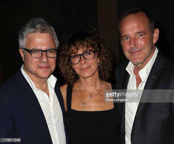 """Neil Pepe, Jennifer Grey and Clark Gregg pose at the Center Theatre Group's """"A Play Is a Poem"""" opening night performance at Mark Taper Forum on..."""