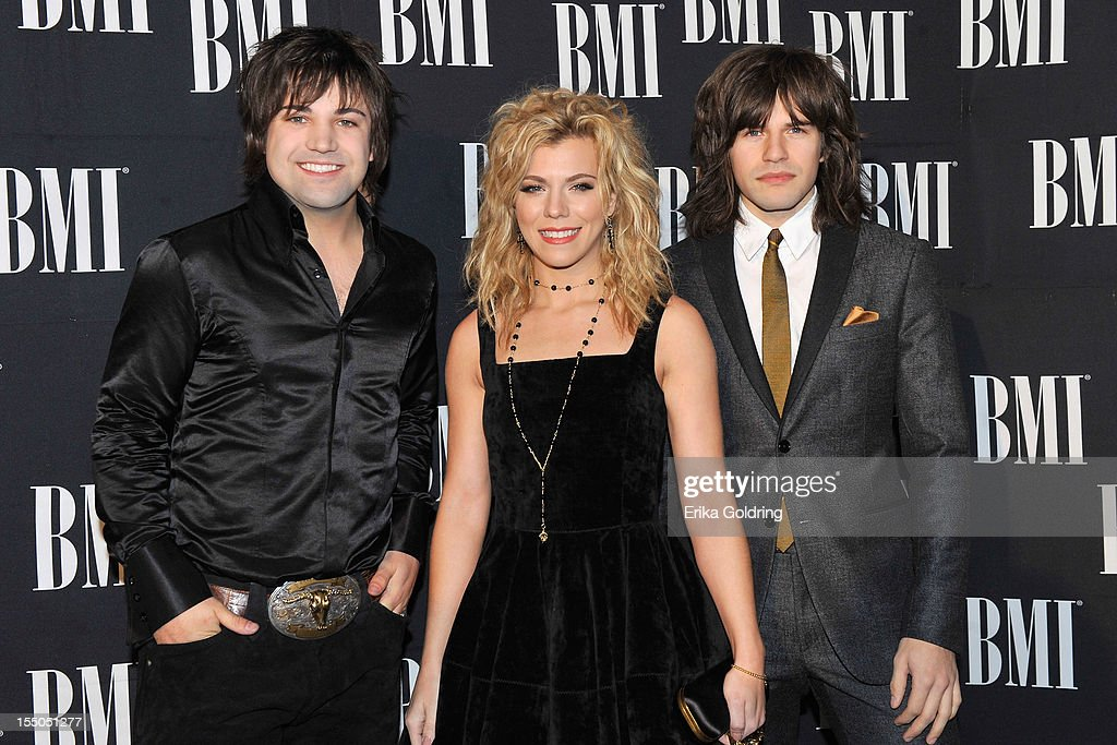 Neil Perry, Kimberly Perry and Reid Perry of The Band Perry attend the 60th annual BMI Country awards at BMI on October 30, 2012 in Nashville, Tennessee.
