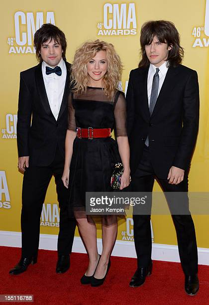Neil Perry Kimberly Perry and Reid Perry of The Band Perry attend the 46th annual CMA Awards at the Bridgestone Arena on November 1 2012 in Nashville...