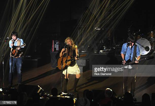 Neil Perry Kimberly Perry and Reid Perry of The Band Perry perform at the WME showcase during the International Entertainment Buyers Association...