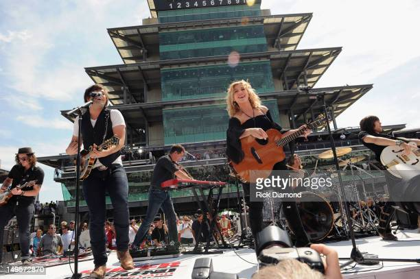 Neil Perry Kimberly Perry and Reid Perry of The Band Perry perform at the Brickyard 400 presented by BigMachineRecordscom at Indianapolis...