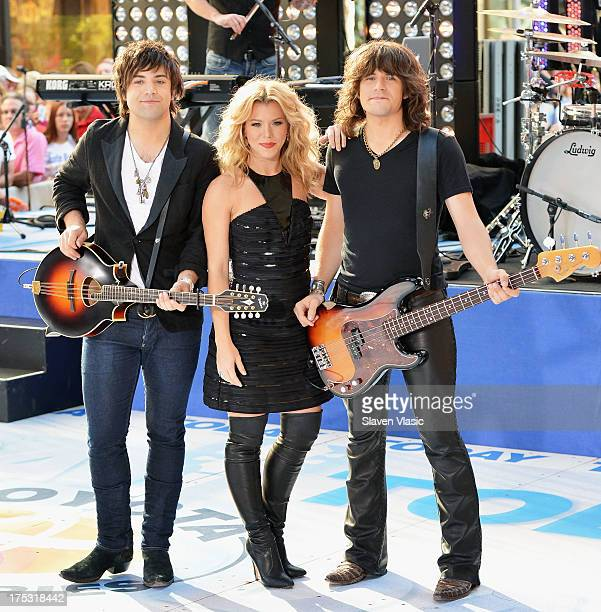 Neil Perry Kimberly Perry and Reid Perry of The Band Perry perform on NBC's 'Today' in Rockefeller Plaza on August 2 2013 in New York New York