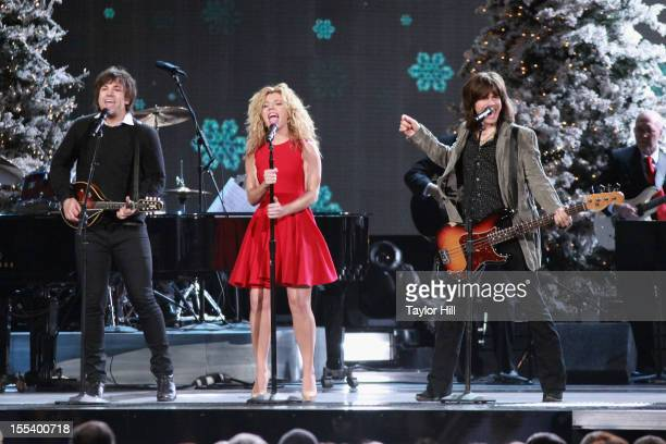 Neil Perry, Kimberly Perry, and Reid Perry of The Band Perry perform during the 2012 Country Christmas at the Bridgestone Arena on November 3, 2012...