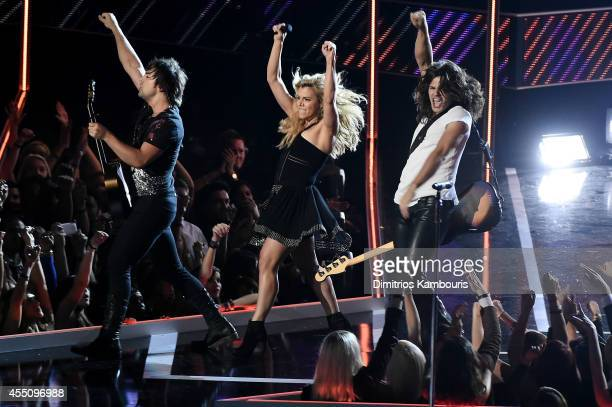 Neil Perry Kimberly Perry and Reid Perry of The Band Perry perform onstage at Fashion Rocks 2014 presented by Three Lions Entertainment at the...