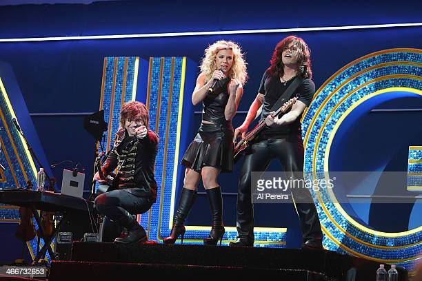 Neil Perry Kimberly Perry and Reid Perry of The Band Perry performs at the Super Bowl XLVIII Pregame Tailgate at Meadowlands Racing Entertainment on...