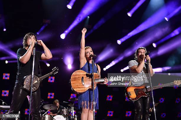 Neil Perry singer Kimberly Perry and Reid Perry of The Band Perry perform onstage during the 2015 CMA Festival on June 12 2015 in Nashville Tennessee