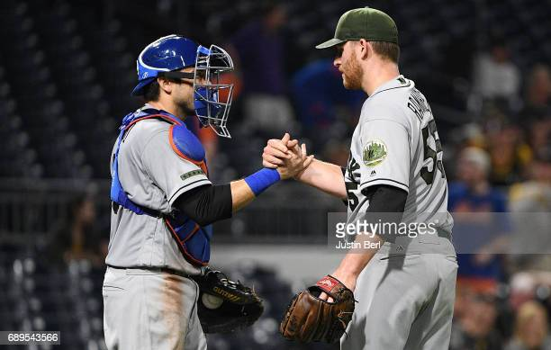 Neil Ramirez of the New York Mets celebrates with Travis d'Arnaud after the final out in the New York Mets 72 win over the Pittsburgh Pirates at PNC...