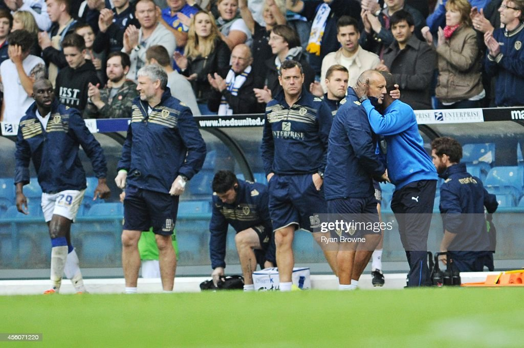 Neil Redfearn of Leeds shakes hands with Chris Powell (r) of Huddersfield Town during Sky Bet Championship match between Leeds United and Huddersfield Town at Elland Road Stadium on September 20, 2014 in Leeds, United Kingdom.