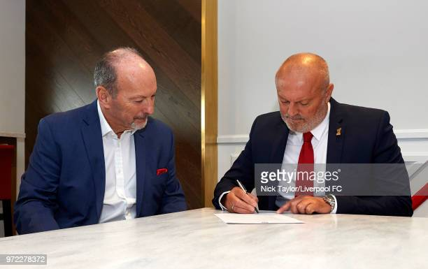 Neil Redfearn signs to become the new manager of Liverpool Ladies with Liverpool FC CEO Peter Moore at Anfield on June 8 2018 in Liverpool England