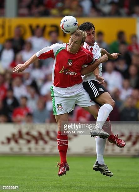 Neil Roberts of Wrexham and Alvaro Arbeloa of Liverpool in action during the Friendly match between Wrexham and Liverpool at The Racecourse Ground on...