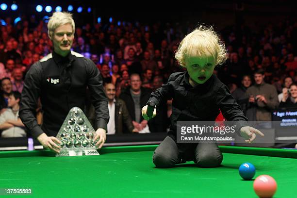 Neil Robertson of Australia and his son Alexander pose with the trophy after vitory over Shaun Murphy of England in the The Final on day 8 of The...