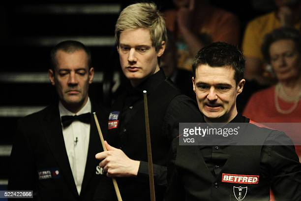 Neil Robertson of Australia and Michael Holt of England react in first round match on day four of Betfred World Championship 2016 at Crucible Theatre...
