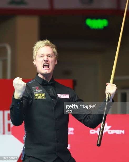 Neil Robertson of Australia celebrates after winning the final match against Mark Selby of England during day seven of the 2013 World Snooker China...