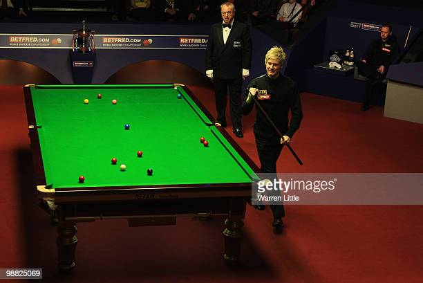Neil Robertson of Australia celebrates beating Graeme Dott of Scotland during the final of the Betfredcom World Snooker Championships at The Crucible...