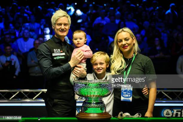 Neil Robertson of Australia celebrates with family after winning the final match against Judd Trump of England during the Champion of Champions 2019...