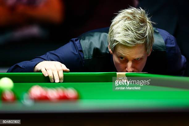 Neil Robertson of Australia eyes up a shot in his first round match against Marco Fu of Hong Kong during Day Four of the Dafabet Masters at Alexandra...