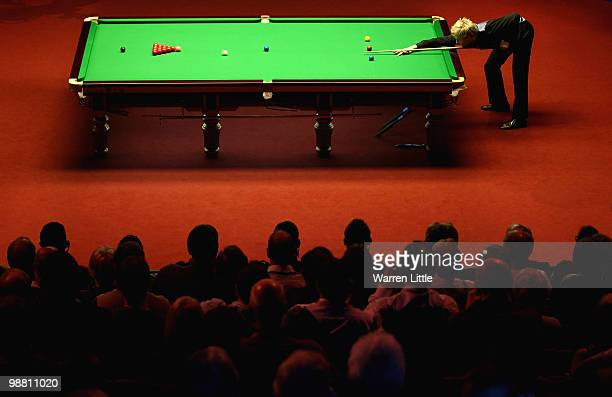 Neil Robertson of Australia in action against Graeme Dott of Scotland during the final of the Betfredcom World Snooker Championships at The Crucible...