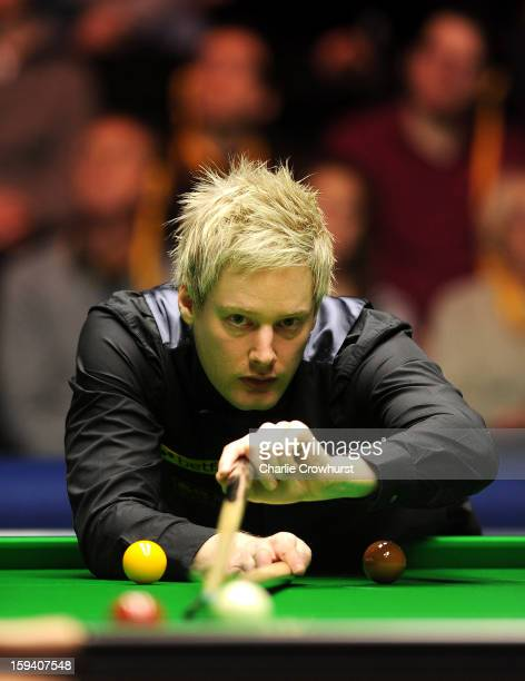 Neil Robertson of Australia in action during his first round match against Ding Junhui of China at Alexandra Palace on January 13 2013 in London...