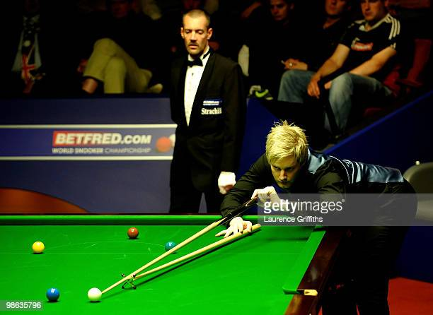 Neil Robertson of Australia in action during his match against Martin Gould of England inthe Betfredcom World Snooker Championships match at The...