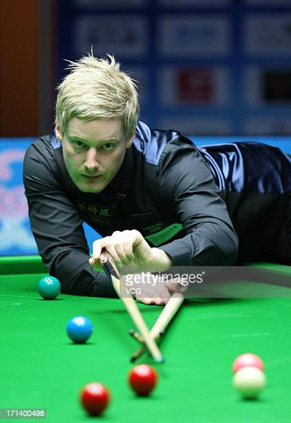 Neil Robertson of Australia plays a shot against John Higgins of Scotland in the final match of Wuxi Snooker Classic at Wuxi City Sports Park Stadium...