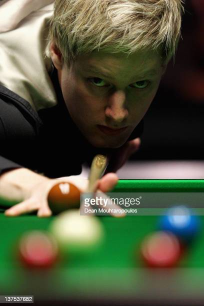 Neil Robertson of Australia plays a shot against Shaun Murphy of England during The Final on day 8 of The Masters at Alexandra Palace on January 22...